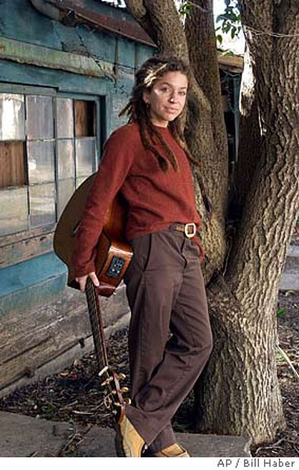 "** ADVANCE FOR FRIDAY, FEB. 13 ** Musician Ani DiFranco stands outside her home in New Orleans Dec. 30, 2003. DiFranco, 33, produced her latest album, ""Educated Guess, on her own as well as playing all the instruments herself. (AP Photo/Bill Haber) Ran on: 02-13-2005 Ran on: 02-13-2005 Photo: BILL HABER"
