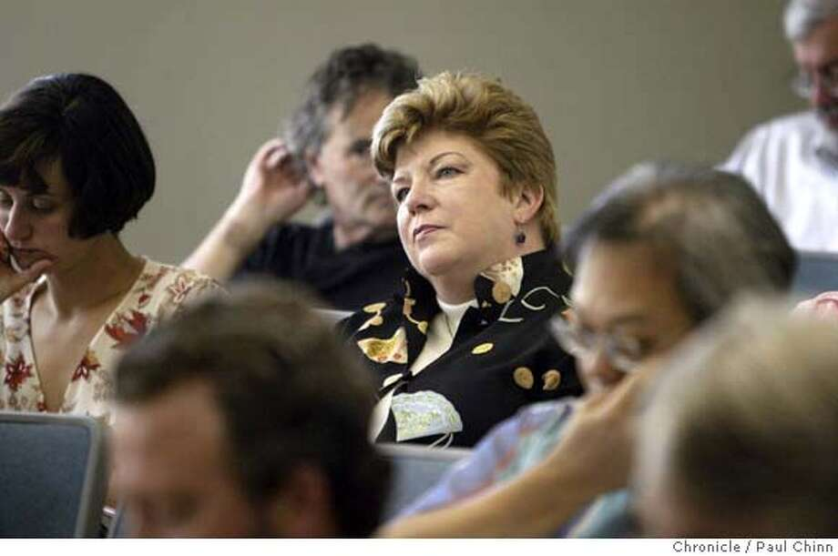 Former state superintendent of public education Delaine Eastin (center) will be teaching at Mills College in the educational leadership program starting this fall. Eastin attended a faculty meeting in Oakland on 8/18/04. PAUL CHINN/The Chronicle Photo: PAUL CHINN