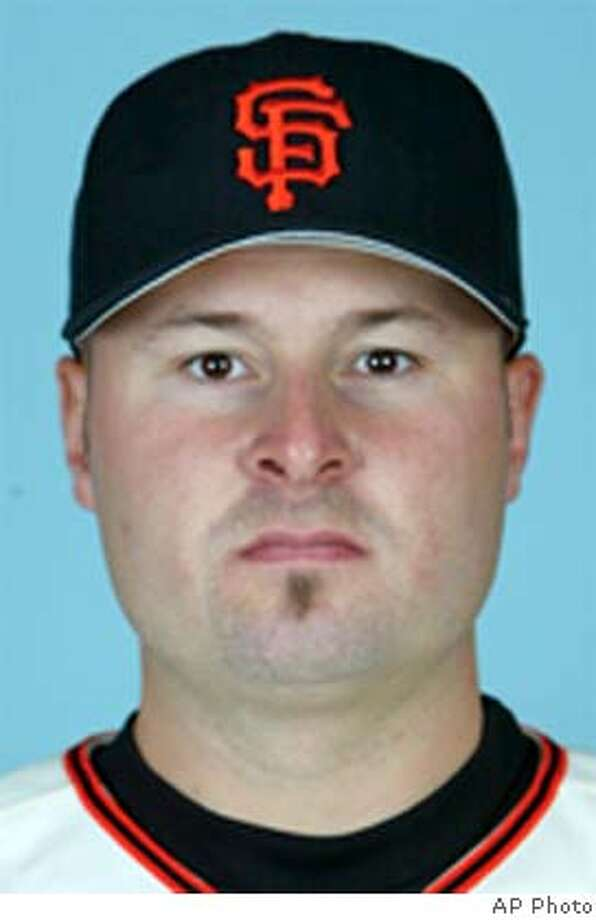 This is a 2003 file photo of Jason Schmidt of the San Francisco Giants baseball team (AP Photo/file) Ran on: 08-18-2004 Ran on: 08-18-2004 cat mug