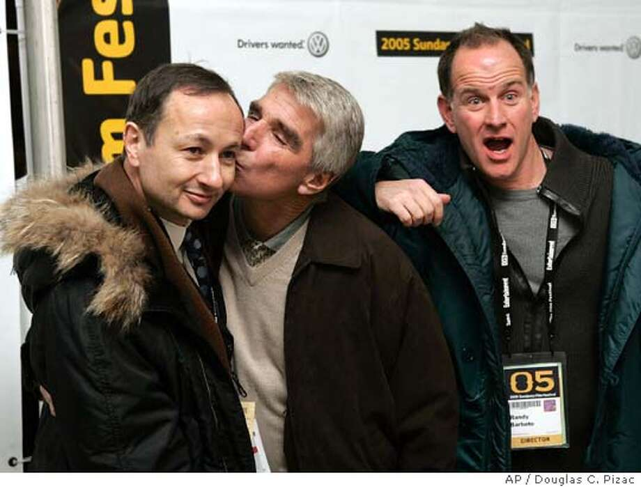 """**FILE**Actor Harry Reems kisses director Fenton Bailey as co-director Randy Barbato, right, strikes a pose at the premier of their film """"Inside Deep Throat"""" Friday, Jan. 21, 2005, in Park City, Utah, during the Sundance Film Festival. The documentary looks at the original 1972 x-rated movie """"Deep Throat"""" and its cultural impact. (AP Photo/Douglas C. Pizac) RETRANSMITTING PHOTO TO GO WITH RERUN OF STORY Photo: DOUGLAS C. PIZAC"""