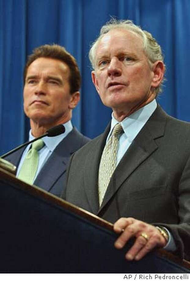 Former state Sen. Bruce McPherson, R- Santa Cruz, right, answers a question after being named as Secretary of State by Gov. Arnold Schwarzenegger, left, during a news conference held at the Capitol in Sacramento, Calif., Friday, Feb. 11, 2005. Schwarzenegger said McPherson, 61, will fill the post being vacated by Democrat Kevin Shelley, who announced his resignation last week. (AP Photo/Rich Pedroncelli) Photo: RICH PEDRONCELLI