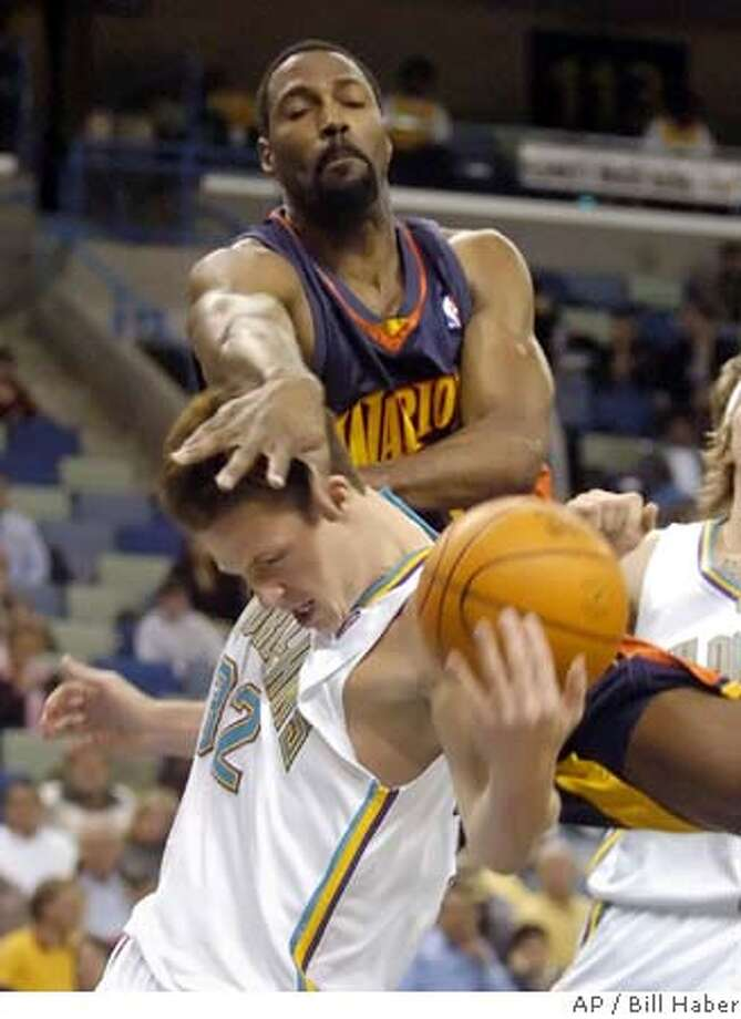 Golden State Warriors' Dale Davis, rear, fouls New Orleans Hornets' Casey Jacobsen (32) in the first half in New Orleans, Friday night, Feb. 11, 2005. (AP Photo/Bill Haber) Photo: BILL HABER