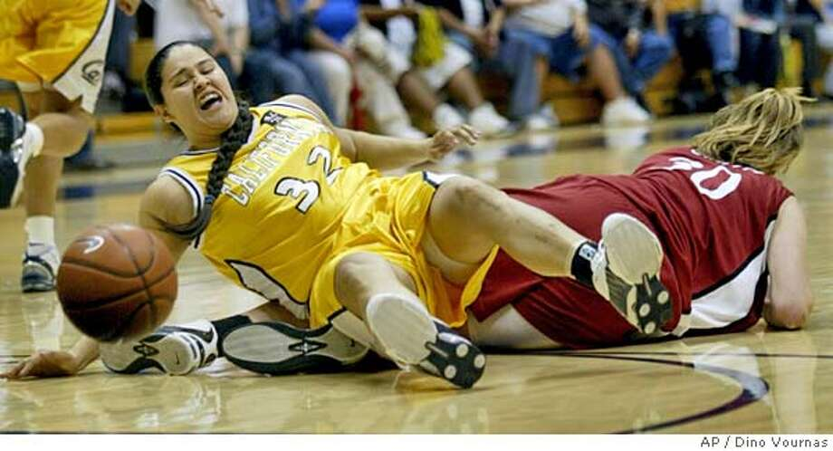 Stanford's Brooke Smith knocks over and fouls California's Jacqueline Sanchez (32) during the first half Friday, Feb. 11, 2005, in Berkeley, Calif. (AP Photo/Dino Vournas) Photo: DINO VOURNAS