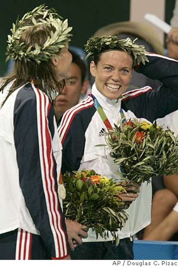 Natalie Couglin, right, of the United States smiles as she and compatriot Jenny Thompson leave the deck after receiving their silver medals in the 4 x 100- medely relay at the Olympic Aquatic Centre during the 2004 Olympic Games in Athens, Saturday, Aug. 21 2004. (AP Photo/Douglas C. Pizac) Photo: DOUGLAS C. PIZAC
