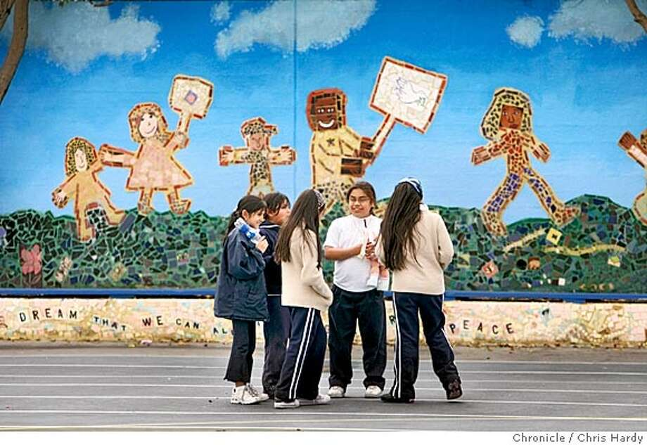 Students at Bret Harte Elementary school spent the school year making a peace-themed mural, which is now lining the wall of their school yard. in San Francisco  2/7/05 Chris Hardy / San Francisco Chronicle Photo: Chris Hardy