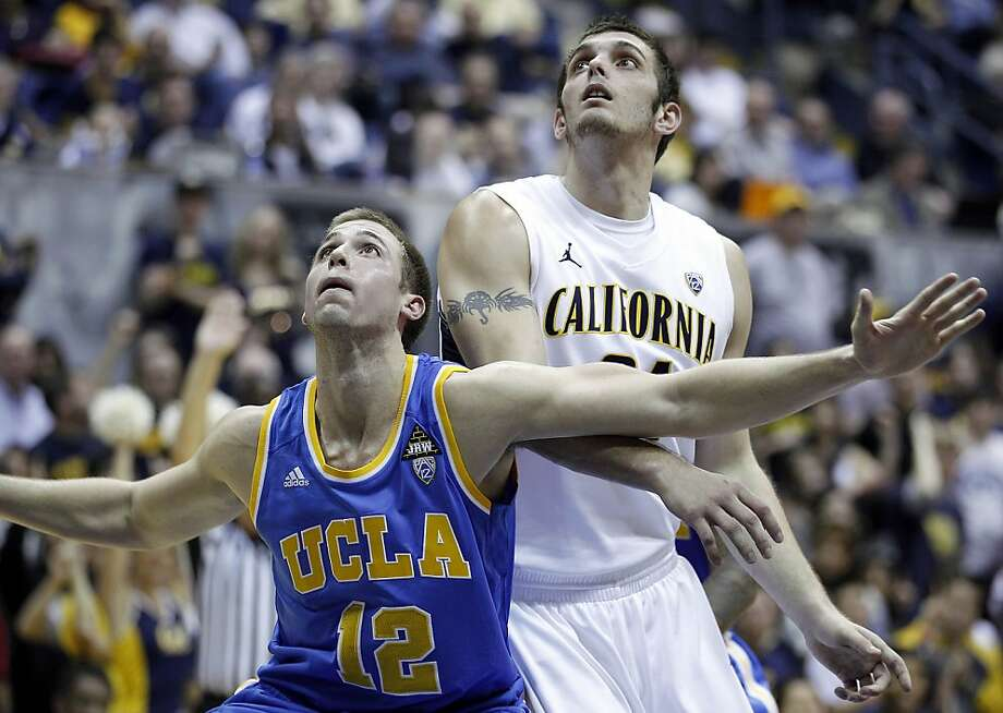 UCLA forward David Wear (12) looks to rebound with California forward Robert Thurman (34) during the second half of an NCAA college basketball game in Berkeley, Calif., Saturday, Dec. 31, 2011. California defeated UCLA 85-69. (AP Photo/Tony Avelar) Photo: Tony Avelar, Associated Press