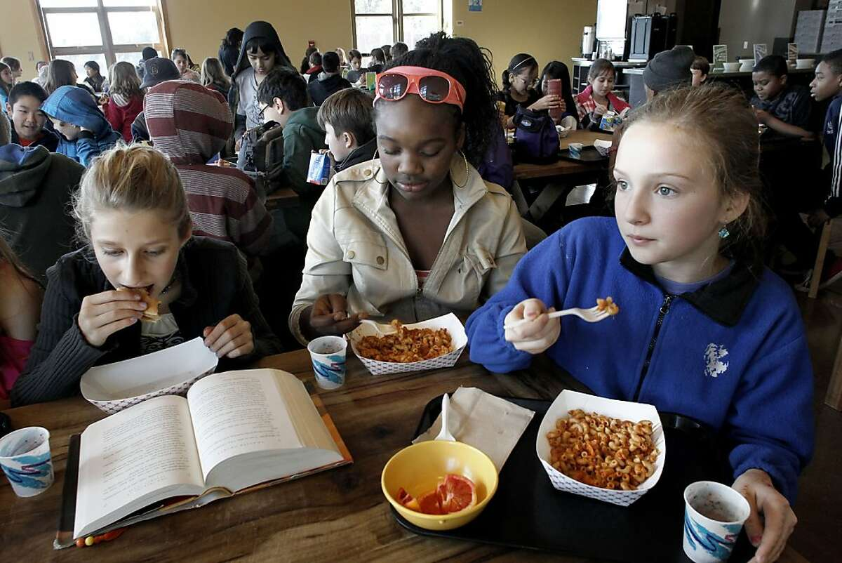 (left to right) Francesca Comacchio, Kayla Faye-Hurd and Nica Eden with their hamburger, pasta primavera and blood for lunch, as the 6th graders take a break at the cafeteria at Martin Luther King Jr, Middle School in Berkeley, Ca., on Wednesday January 25, 2012. The Federal government announced today new school lunch regulations.