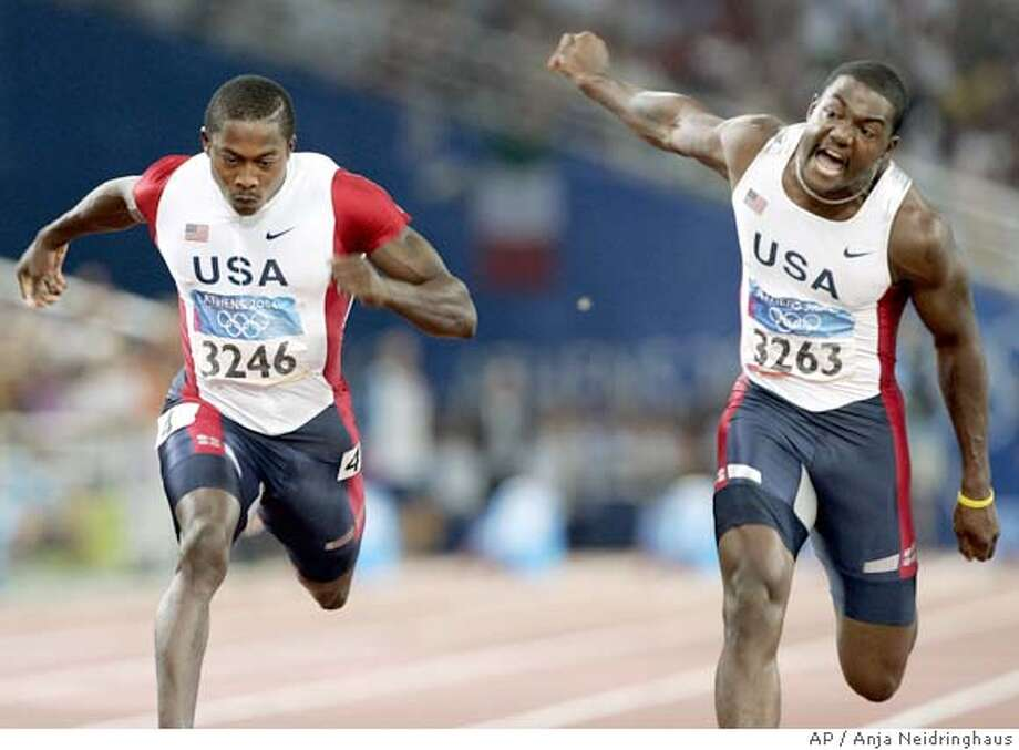 Justin Gatlin, of the United States (3263) crosses the finish line to win the gold medal ahead of compatriot Shawn Crawford (3246) in the 100-meters at the Olympic Stadium during the 2004 Olympic Games in Athens, Sunday, Aug. 22, 2004. Crawford finished fourth. (AP Photo/Anja Neidringhaus ) Photo: ANJA NEIDRINGHAUS
