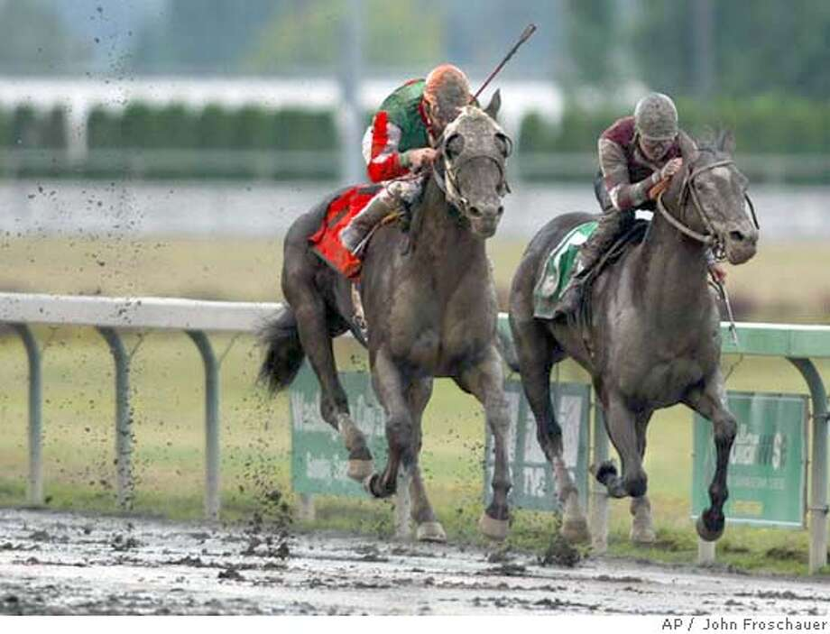 Russel Baze riding Adreamisborn, left edges out Nathan Chaves riding Demon Warlock on a sloppy track to win the 69th running of the $250,000 grade III at Emerald Downs track in Auburn Wash. Sunday Aug. 22, 2004. Baze is from San Francisco area and the horse, Adreamisborn is Kentucky bred and owned by Franks Farms. (AP Photo/King County Journal, John Froschauer) Photo: JOHN FROSCHAUER
