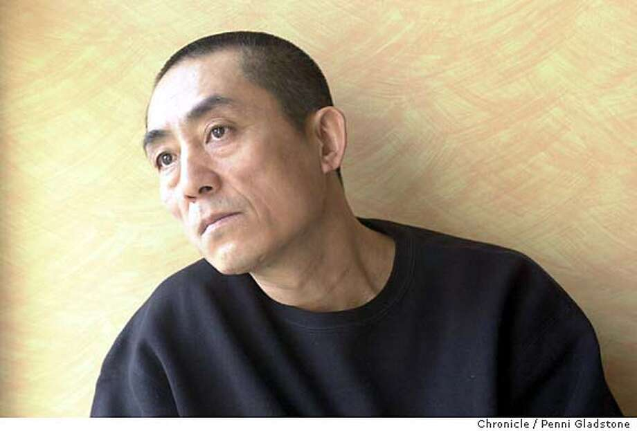 "ZHANG29B-C-26APR02-DD-PG  filmmaker Zhang Yimou in SF, at Hotel Monaco Zhang Yimou is best known for his internationally acclaimed film """"Raise the Red Lantern.'' His new movie is """"Happy Times,'' PHOTOGRAPHY BY PENNI GLADSTONE Photo: PENNI GLADSTONE"