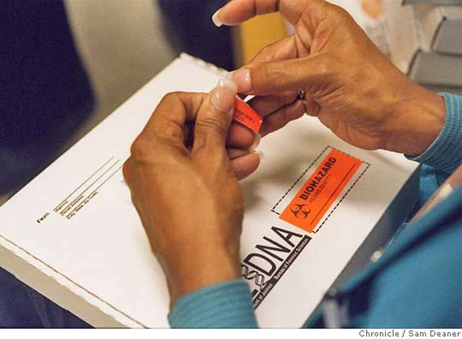 DNA08-C-06OCT99-MN-SD - At Santa Rita Jail in Dublin Phlebotomist Rita Flournoy seals a DNA kit used to collect DNA from sexual and violent offenders as part of the DNA program pursuant to California's Penal Code Section 296. California has released thousands of violent prisoners without collecting their genetic samples as required by state law. CHRONICLE PHOTO By SAM DEANER Ran on: 08-22-2004  A phlebotomist seals a kit used to collect DNA from sexual and violent offenders, as California requires, at Dublin's Santa Rita Jail. Photo: SAM DEANER