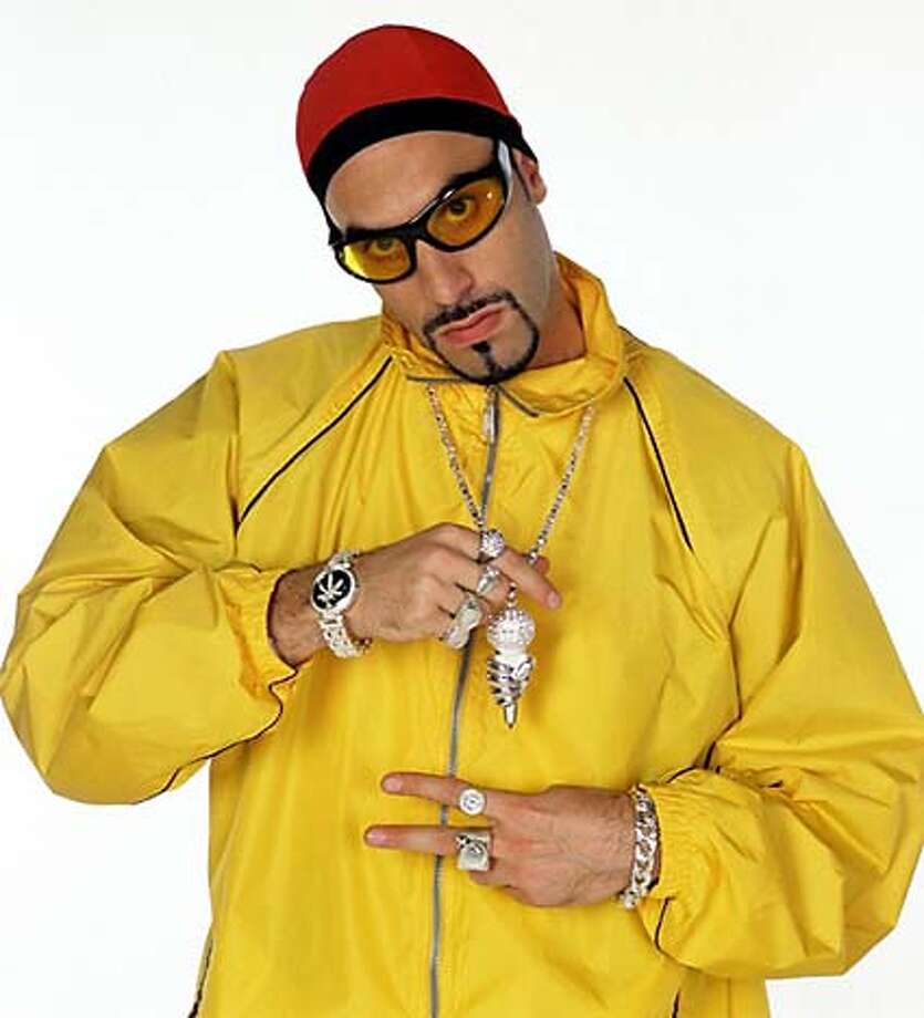 "(NYT17) UNDATED -- Feb. 20, 2003 -- TV-ALI-G-REVIEW-2 -- ""Da Ali G Show,"" which begins Friday night, Feb 21 on HBO, is irresistibly, corrosively funny. Ali G is the stage name of Sacha Baron Cohen, a British comedian who is famous in England as his comic persona, a white gangsta rapper wannabe who speaks a strangled argot of cockney, Jamaican and hip-hop slang. The British comedian Sacha Baron Cohen in costume and character as Ali G. (Oliver Upton/HBO/The New York Times) *ONLY FOR USE WITH STORY BY ALESSANDRA STANLEY SLUGGED: TV-ALI-G-REVIEW. ALL OTHER USE PROHIBITED. CAT XNYZ, HFO, *ONLY FOR USE WITH STORY BY ALESSANDRA STANLEY SLUGGED: TV-ALI-G-REVIEW. ALL OTHER USE PROHIBITED. Photo: OLIVER UPTON"