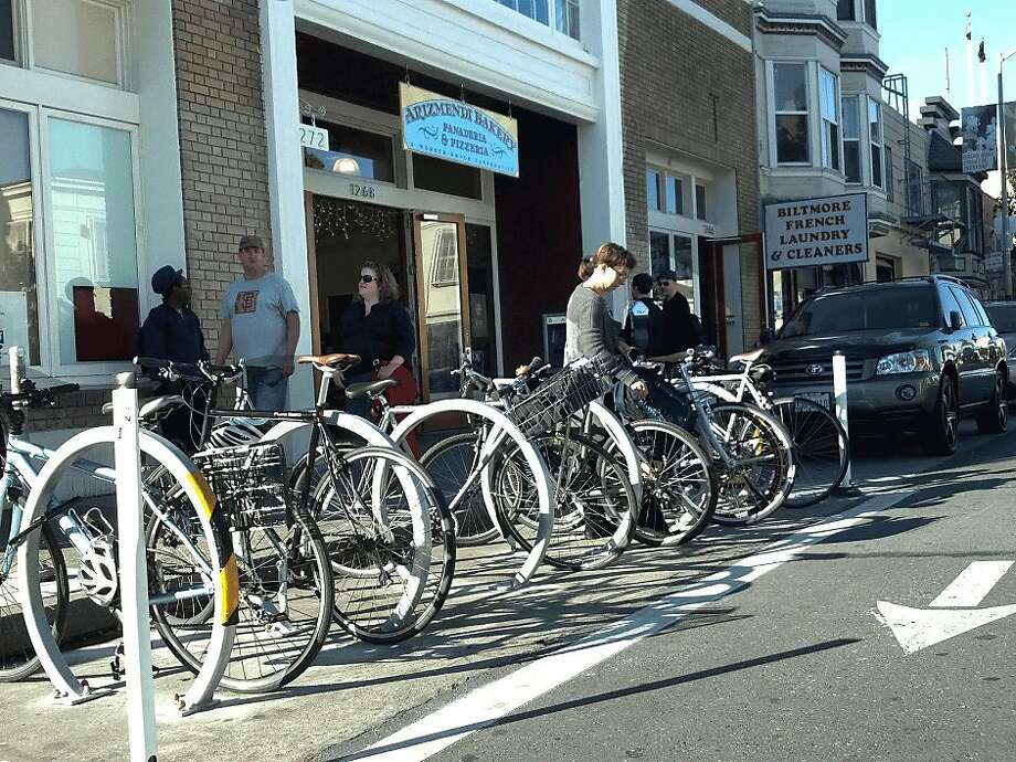 This bike corral, in front of Arizmendi Bakery on Valencia Street, is one of some two dozen across the city. Photo: S.F. Bicycle Coalition