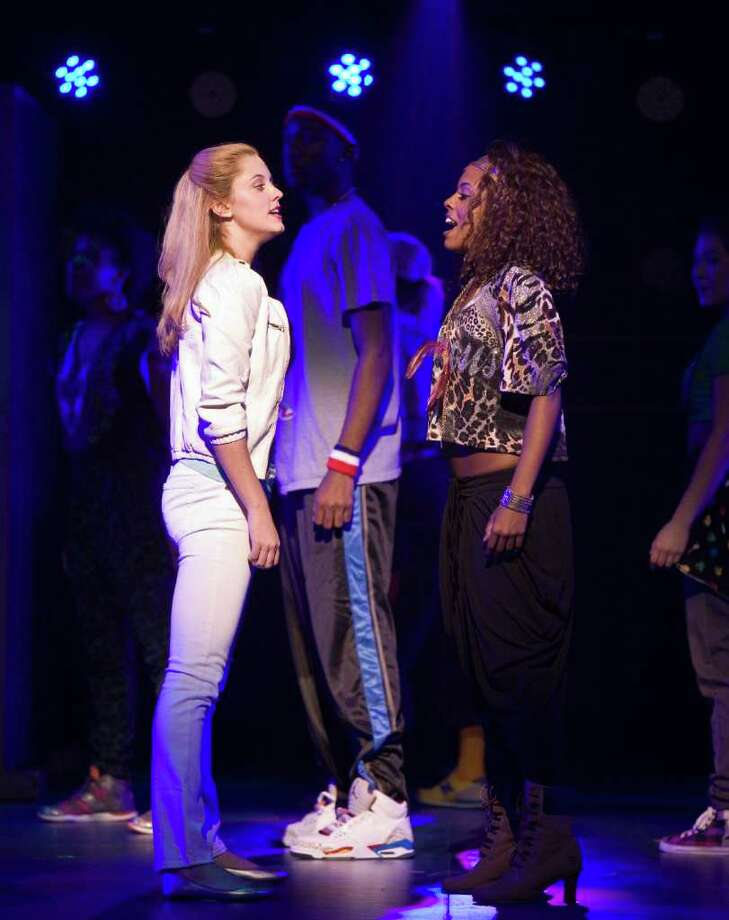 Campbell (Taylor Louderman, left) and Danielle (Adrienne Warren) must learn to work together in Bring It On. The touring musical, set in the world of competitive high school cheerleading, is playing at Hobby Center. Photo: Craig Schwartz
