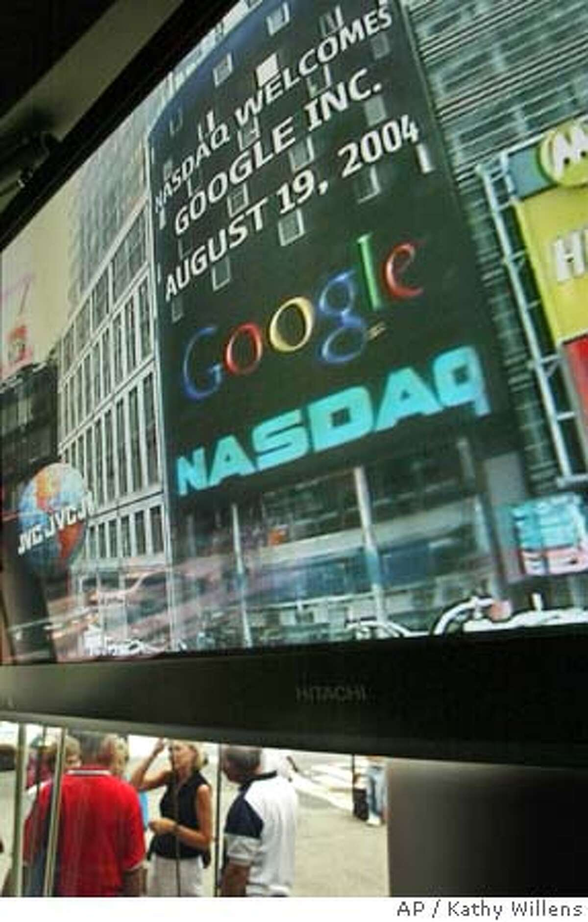 A sign welcoming Google to the Nasdaq market is shown on a video screen inside the Times Square headquarters of the electronic market shortly after shares of the company began trading at midday, Thursday, Aug. 19, 2004, in New York. (AP Photo/Kathy Willens)
