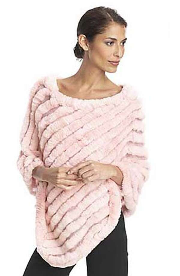 BCBG rabbit fur poncho (also comes in black), $198, at Nordstrom stores  HANDOUT