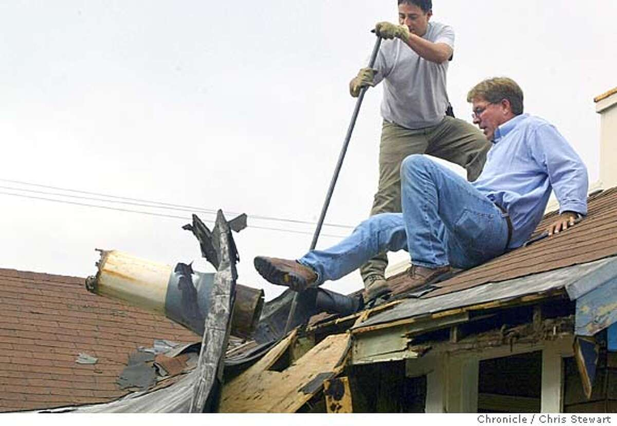 Event on 8/13/04 in San Francisco Two houses at 4329 Kirkham Street (at 47th Ave.) in the outer Sunset, which were cobbled together from four earthquake cottages (built for families made homeless by the 1906 earthquake) are being dismantled by carpenters. They are removing the modern-day roofs, siding, and add-on rooms to unearth the original one-room buildings. Eventually, the four redwood cottages will be moved to Treasure Island, where they will be restored to their former -- albeit-- humble glory. Chris Stewart / The Chronicle