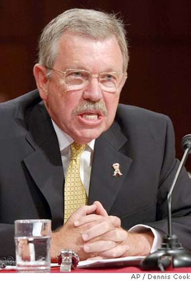 Former U. S. weapons inspector David Kay testifies on recomendations of the Sept. 11 commission on Capitol Hill Wednesday, Aug. 18, 2004, before the Senate Intelligence Committee. (AP Photo/Dennis Cook) Photo: DENNIS COOK