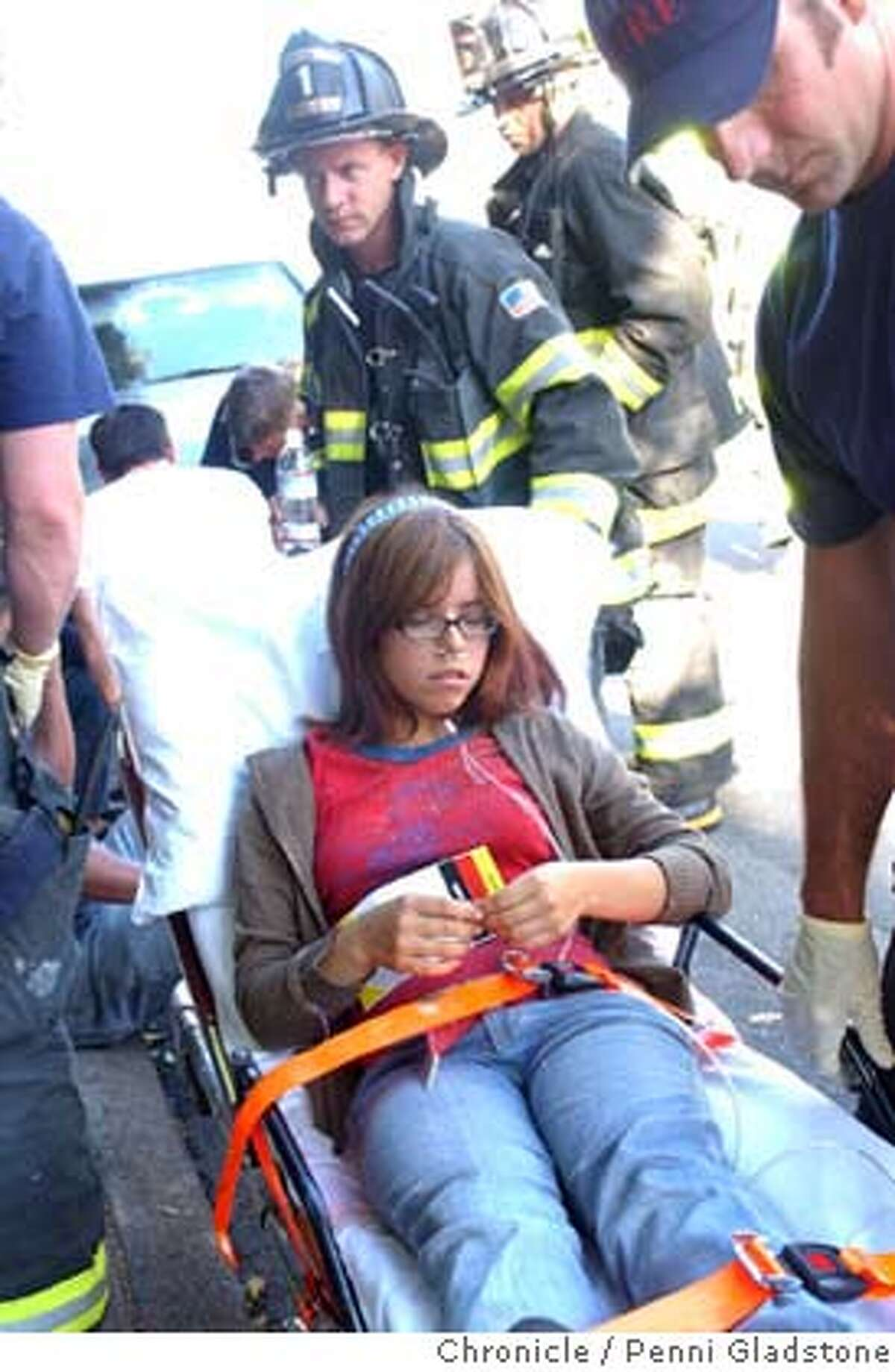 Zoe Mendez hurt in the theater goes to the hospital. Sequoia Theatre in Mill Valley was showing a matinee when part of the roof collapsed on the patrons who then ran out of the building covered in insulation. MV police and Sherriff and MV fire responded. About 33 people were in the theatre. 3 taken to hospital (ck) 8/16/04 in Mill Valley. Penni Gladstone / The Chronicle