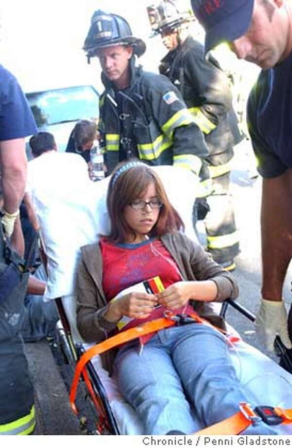 Zoe Mendez hurt in the theater goes to the hospital.  Sequoia Theatre in Mill Valley was showing a matinee when part of the roof collapsed on the patrons who then ran out of the building covered in insulation. MV police and Sherriff and MV fire responded. About 33 people were in the theatre. 3 taken to hospital (ck) 8/16/04 in Mill Valley.  Penni Gladstone / The Chronicle Photo: Penni Gladstone