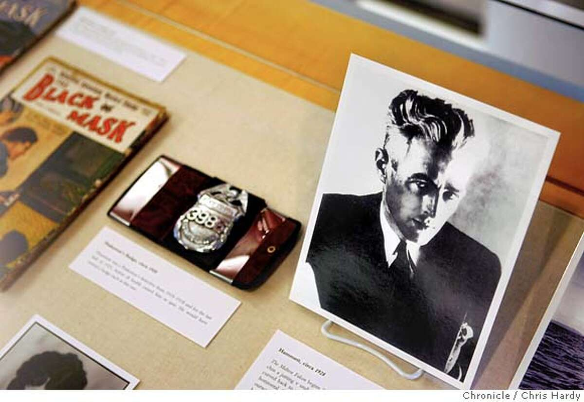 020205_hammettexhibit07_ch_032.jpg Picture of Hammett, a Pinkerton badge like the one he had, and some pulp magazines Hammett used to write for. The San Francisco Public Library's exhibit of Dashiell Hammett's letters, his typewriter and other Falcon-related artifacts. in San Francisco 2/2/05 Chris Hardy / San Francisco Chronicle