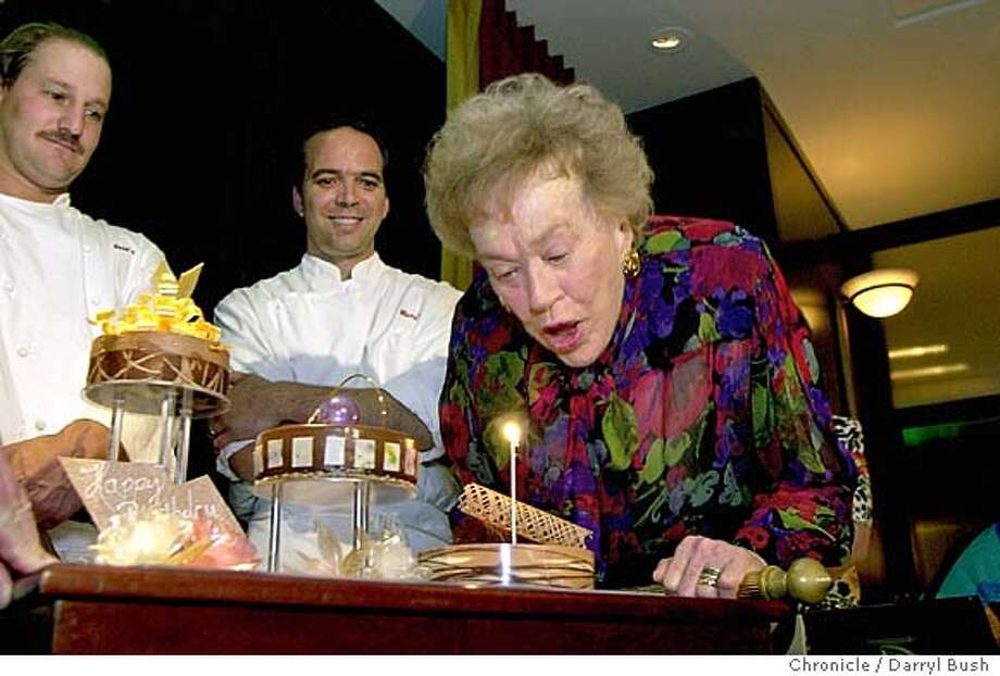 CIRCUIT0104A-C-01AUG02-MG-DB Julia Child blows out a candle on a special birthday cake, at her 90th birthday party as chefs, Ron Siegel, left, and Keith Jeanminette left, look on, at the event held at the Fifth Floor restaurant in San Francisco. Chronicle Photo by Darryl Bush CAT Photo: Darryl Bush
