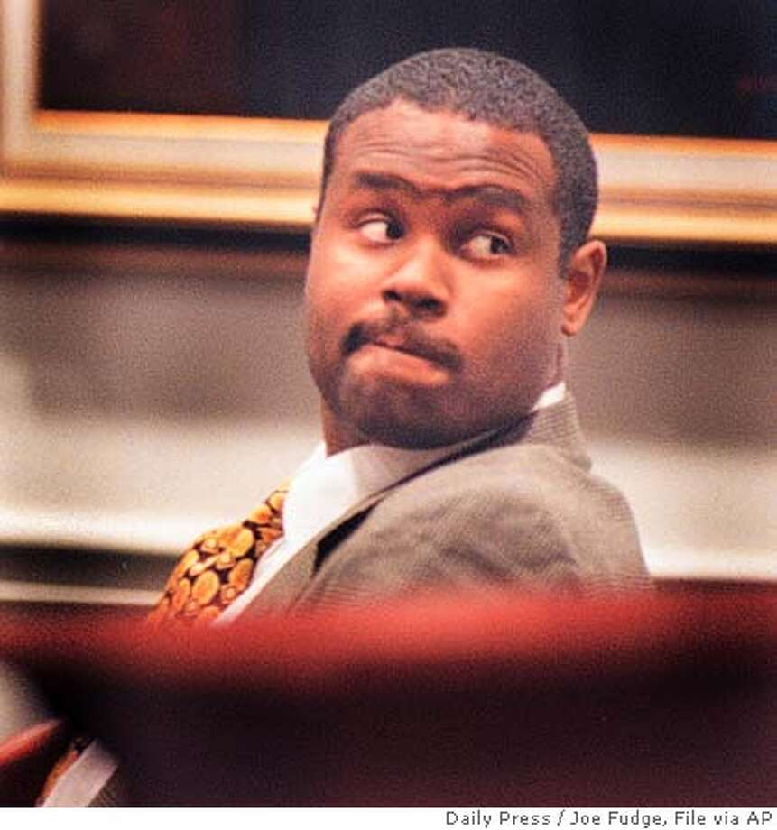 **FILE **Daryl Renard Atkins sits in a York-Poquoson courtroom in York, Va., in this February 1998 file photo. A divided Supreme Court reversed itself Thursday, June 20, 2002, and ruled that executing the mentally retarded is unconstitutionally cruel. The court ruled in favor of Atkins, a Virginia inmate , who was convicted of shooting an Air Force enlisted man for beer money in 1996. Atkins' lawyers say he has an IQ of 59 and has never lived on his own or held a job.(AP Photo/Daily Press, Joe Fudge,file) CAT February 1998 file photo Photo: JOE FUDGE