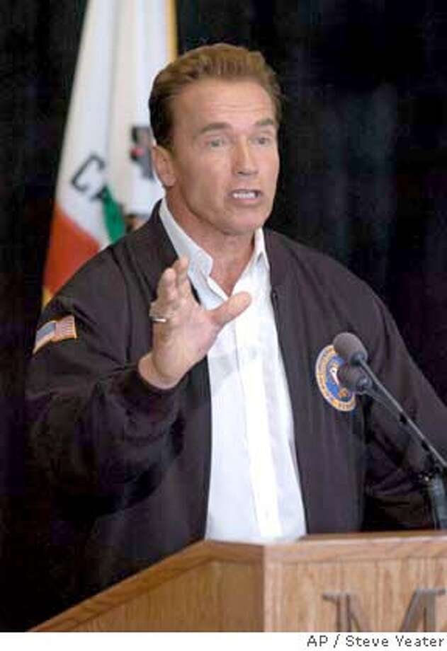 California Gov.Arnold Schwarzenegger answers questions during a news conference at Mule Creek State Prison in Ione, Calif., Monday, Aug. 16, 2004. The Governor called for intensified efforts to reform the state's prison system after a tour of Mule Creek which is considered a model facility. (AP Photo/Steve Yeater) Photo: STEVE YEATER