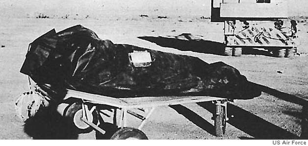 "FILE--This photo is from the Air Force's ""The Roswell Report,"" released Tuesday, June 24, 1997, which discusses the UFO incident in Roswell, N.M. in 1947. On balloon flights, test dummies were used and placed in insulation bags to protect temperature sensitive equipment. These bags may have been described by at least one witness as ""body bags"" used to recover alien victims from the crash of a flying saucer. The 231-page report, released on the eve of the 50th anniversary of the Roswell, N.M., UFO incident, is meant to close to book on longstanding rumors that the Air Force recovered a flying saucer and extraterrestrial bodies near Roswell. (AP Photo/Air Force, File) BLACK AND WHITE ONLY / DATE AND PLACE OF PHOTO UNKNOWN Ran on: 08-16-2004"