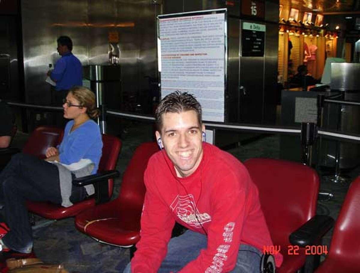 Obituary photo of Matthew Carrington on his way to his 21st birthday celebration (with his family). November, 2004