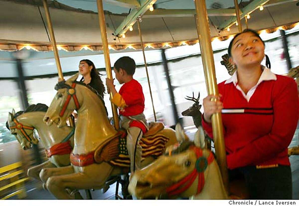 BERKELEY15_0118_LI.JPG Where passion is married to intelligence, your most likely are in the city of Berkeley. Alice Tam (right) age15 from Oakland rides the Tilden Park Merry-Go-Round with friends from Family Bridges Community Center in Oakland. The carousel was built in 1911 and installed at the Berkeley Park in 1948. By Lance Iversen/San Francisco Chronicle MANDATORY CREDIT FOR PHOTOG AND SF CHRONICLE/ -MAGS OUT-WIRES SERVICES OUT/GARY FONG
