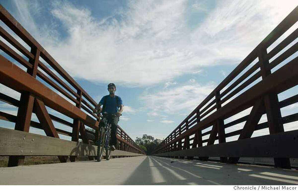 parks019_mac.jpg Keith Nunes of Concord crosses the bridge at Concord Ave. to get to his job at Home Depot. He uses the trail to commute to work and says it saves him half the time using the trail, compared to city streets. A look along the