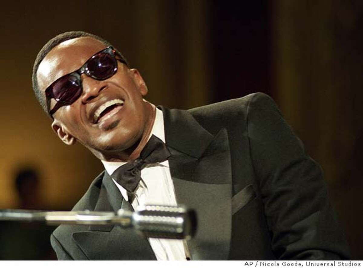 This promotional photo provided by Universal Studios shows actor Jamie Foxx as American legend Ray Charles in a scene from