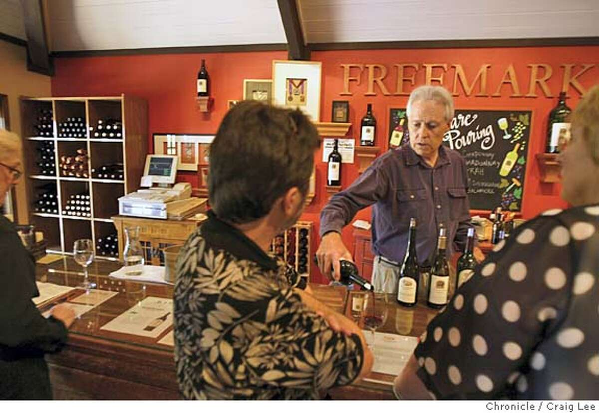 Freemark Abbey wine tasting room in St. Helena. Photo of Bob Leonard pouring wine from behind the counter. Event on 7/23/04 in St. Helena. Craig Lee / The Chronicle
