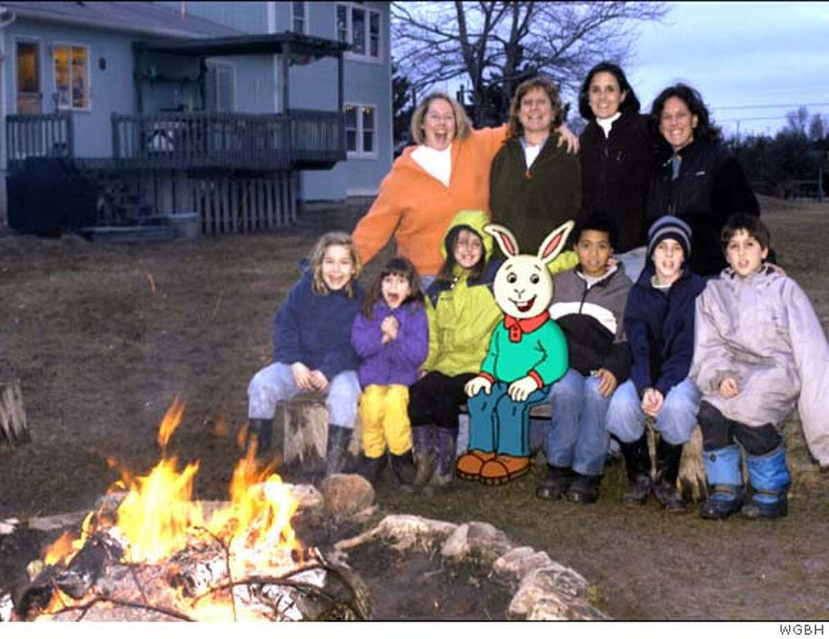 Two families headed by same-sex couples pose with Buster the rabbit in an episode of a PBS kids' show that angered the Bush administration. Photo courtesy of WGBH