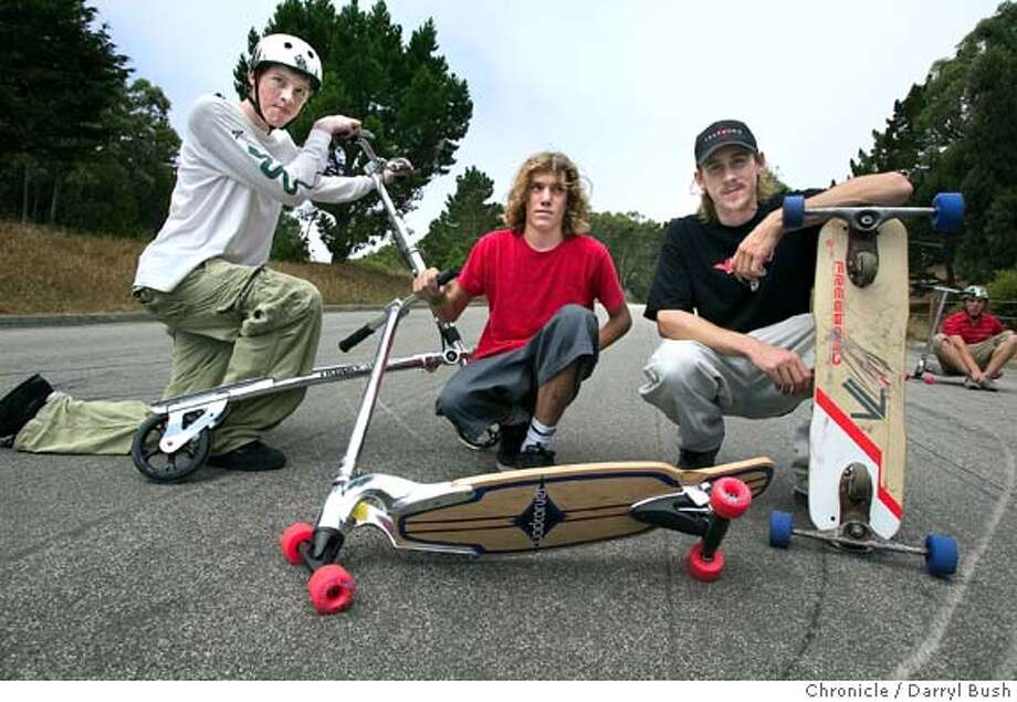 From left is: Jack Cole of San Francisco, 15, holding a Trikke, Jake Santos, 15, of San Lorenzo holding a Quadcarver, and John Laudin, 21, of Walnut Creek, holding a Freeboard, right. New wheeled rolling toys: Quadcarver, Trikke, and Freeboard at McLaren Park. 8/6/04 in San Francisco  Darryl Bush / The Chronicle Photo: Darryl Bush