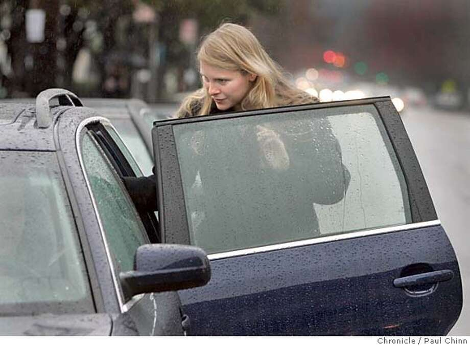 carpools_025_pc.jpg  Helen Wolff gets into the back seat of a car headed for SF. Commuters wait in line at the casual carpool staging area near the intersection of College and Claremont on 1/26/05 in Oakland, CA.  PAUL CHINN/The Chronicle MANDATORY CREDIT FOR PHOTOG AND S.F. CHRONICLE/ - MAGS OUT Photo: PAUL CHINN
