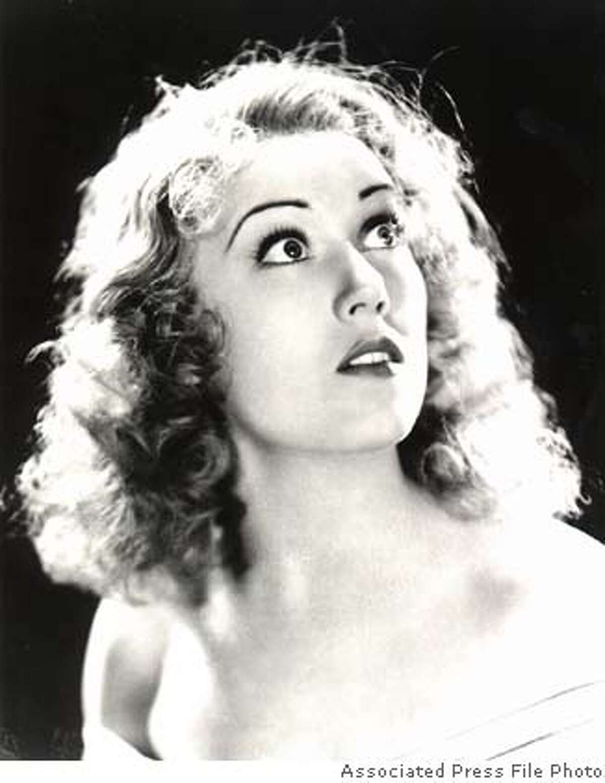 """**FILE**This is an undated picture of Fay Wray, best-remembered as the beautiful woman held by the giant gorilla in """"King Kong,"""" the 1933 classic film. Wray, 96, died Sunday, Aug.8, 2004, at her Manhattan apartment, said Rick McKay, a friend and director of the last film she appeared in.(AP Photo)"""