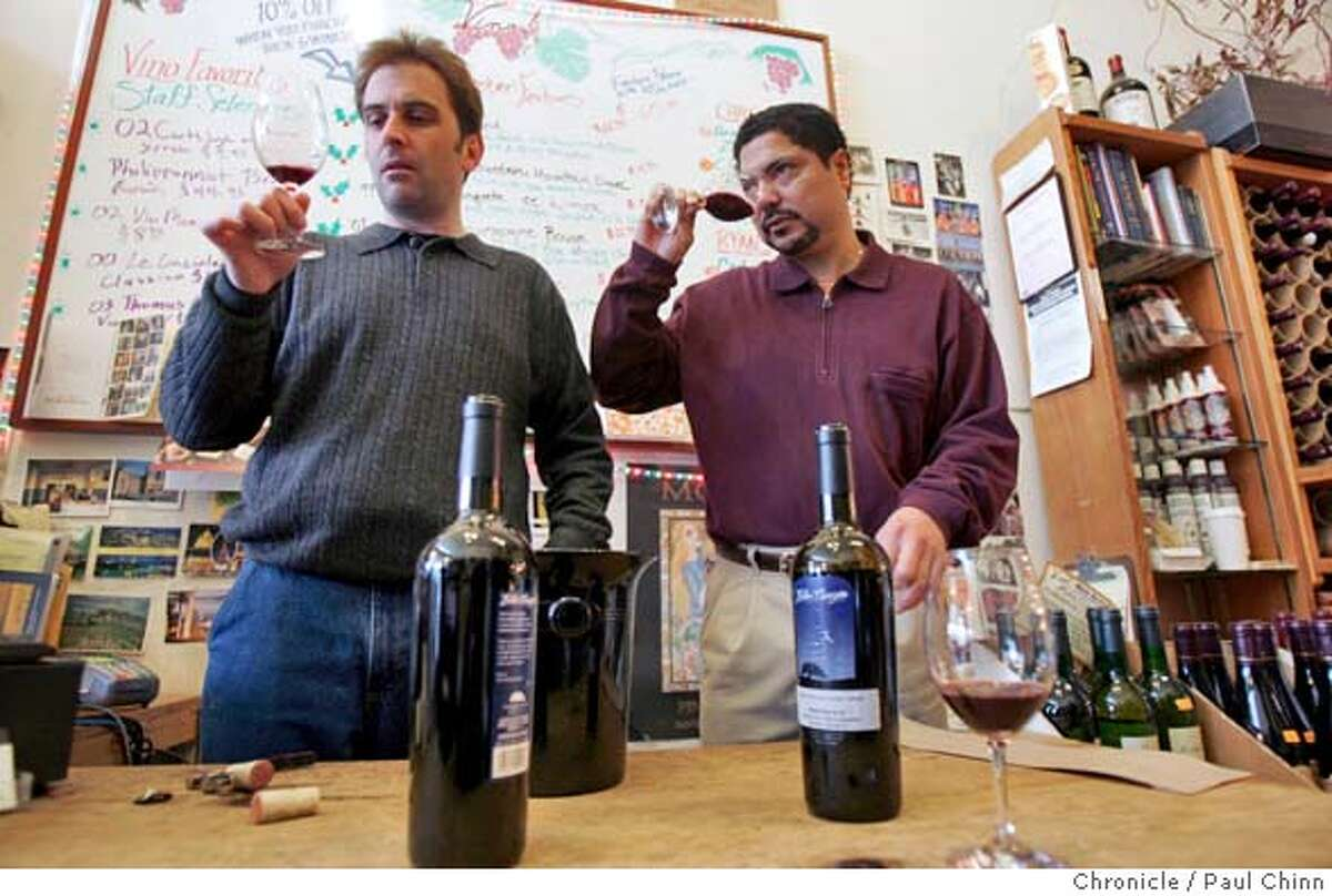 filwinemakers_085_pc.jpg Ryan Fitzinger (left) and Carl Davidson, of Vino wine shop, sample the Villamins' cabernet. Elaine Villamin and her father Danny Villamin deliver cases of their Eden Canyon cabernets to a wine merchant on 1/7/05 in Oakland, CA. The Villamins may be the first Filipino American family to grow its own grapes and make its own wine. PAUL CHINN/The Chronicle MANDATORY CREDIT FOR PHOTOG AND S.F. CHRONICLE/ - MAGS OUT