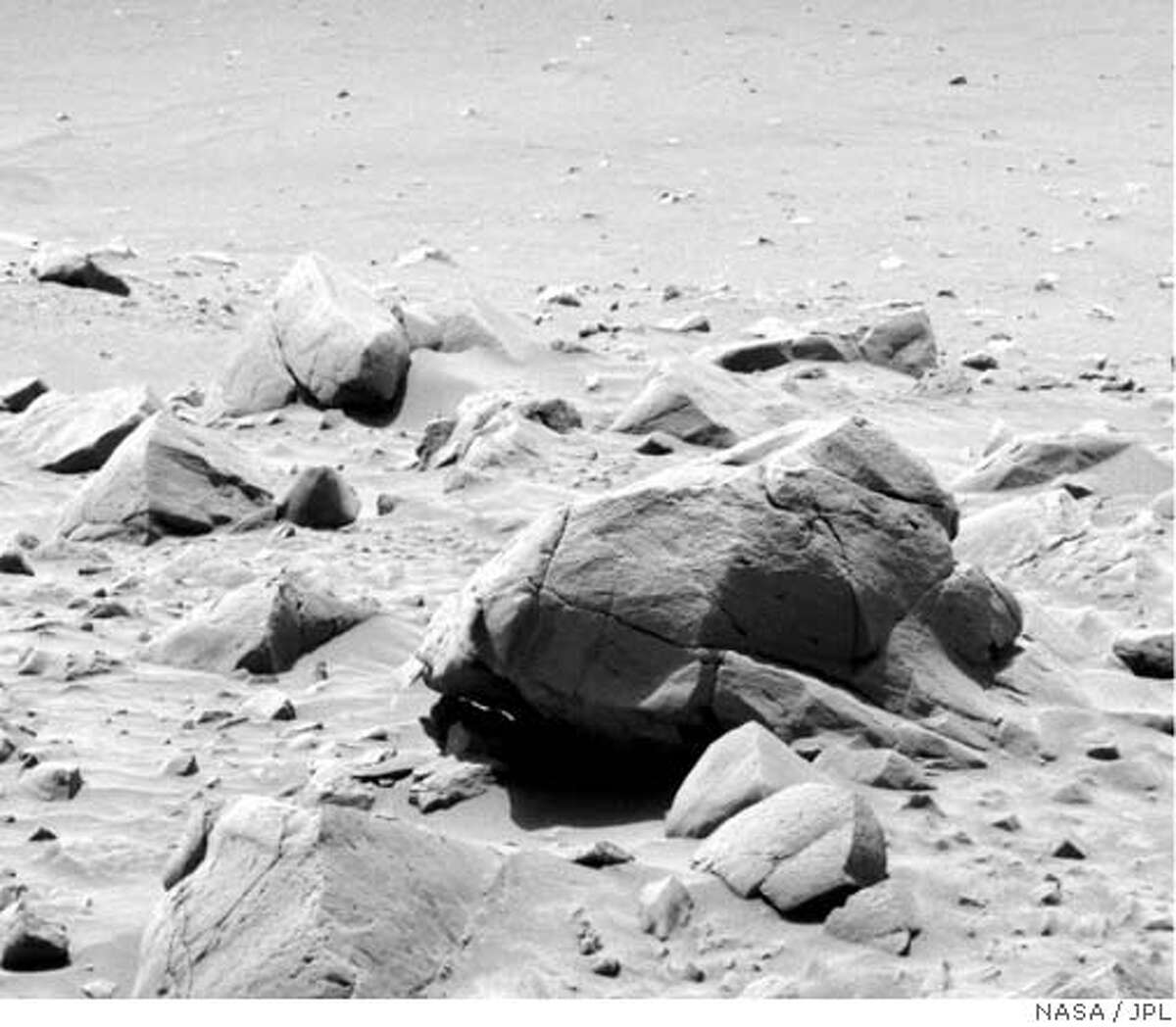 Fractured rock block near rim of Bonneville crater taken by Panoramic camera aboard the Spirit rover. Courtesy of Cornell/JPL/NASA