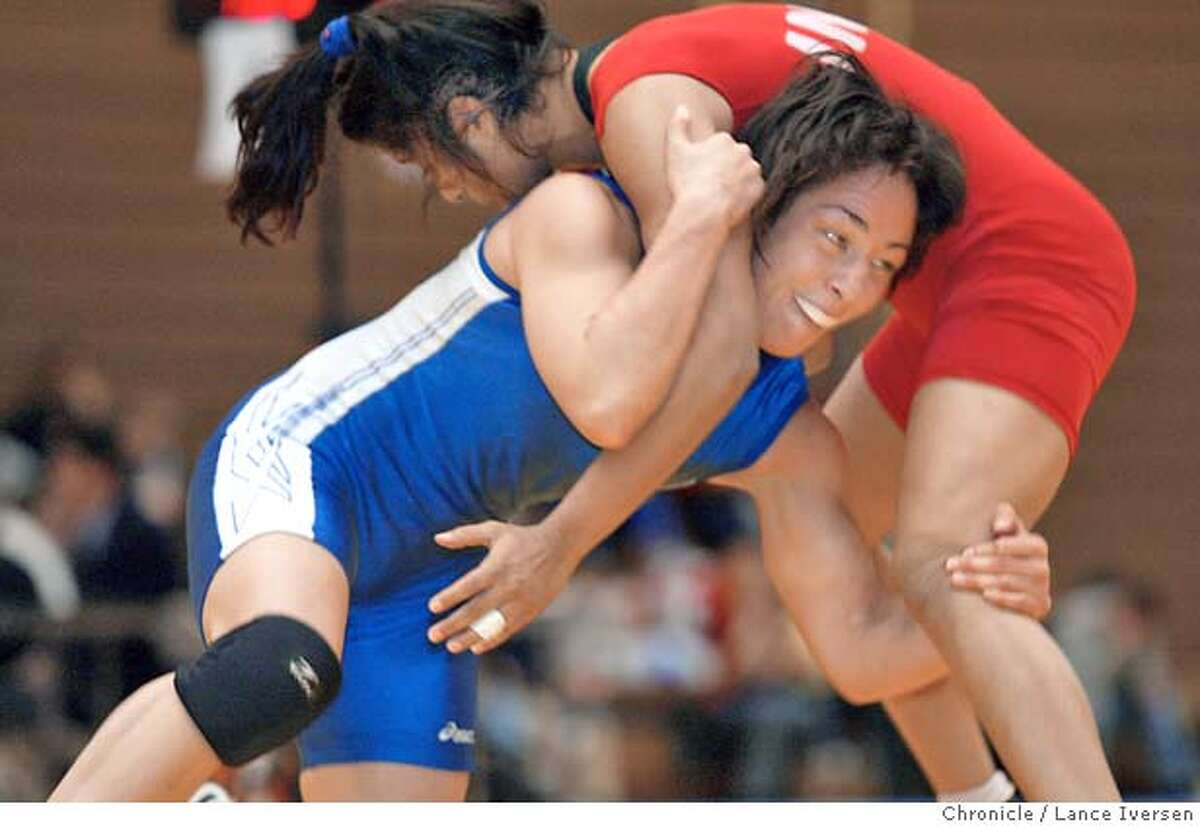 WRESTLEXX0189a_LI.jpg wrestler Patricia Miranda from Saratoga Ca, works on the lower body of Shumel Miya from India. match at the US Olympic Center in Colorado Springs Saturday. Miranda is the odds on favorite to take home a medal at this year's summer Olympics in Athens. By Lance Iversen/San Francisco Chronicle. MANDATORY CREDIT FOR PHOTOG AND SF CHRONICLE/ -MAGS OUT-WIRE SERVICES OUT Gary Fong 415-777-8428