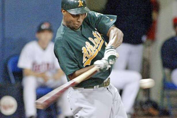 Oakland Athletics Jermaine Dye (24) connects for an RBI single against the Minnesota Twins during the i8th inning Sunday, Aug. 8, 2004, in Minneapolis. The run was the eventual game-winner as Oakland won 6-5 in 18 innings. (AP Photo/Paul Battaglia)