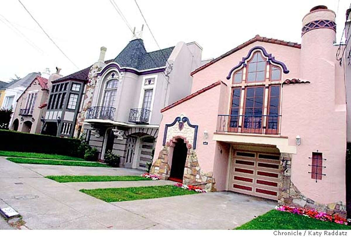 SHOWN: On the RIGHT is the Spanish-style Rousseau house belinging to the Zamboukos family in San Francisco; to the house's right are two more Rousseau houses. Story about Oliver Rousseau, who built many of the Spanish, Tudor, French, and Mediterranean style houses in the Sunset District of San Francisco. Katy Raddatz / The Chronicle