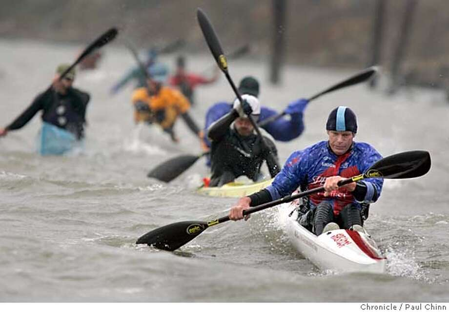 paddlers27_170_pc.jpg  Mike Shea leads a pack of paddlers on the long race course. The Wavechaser series of outrigger canoe races on 1/22/05 in Benicia, CA.  PAUL CHINN/The Chronicle MANDATORY CREDIT FOR PHOTOG AND S.F. CHRONICLE/ - MAGS OUT Photo: PAUL CHINN