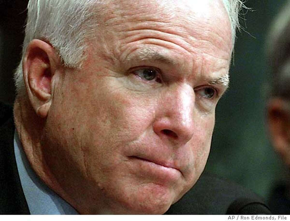 """**FILE** Sen. John McCain, R-Ariz. is shown in this May 11, 2004, file photo, in Washington. McCain, a former prisoner of war in Vietnam, called an ad criticizing John Kerry's military service """"dishonest and dishonorable"""" and urged the White House on Thursday, Aug. 5, 2004, to condemn it as well. (AP Photo/Ron Edmonds, File)"""