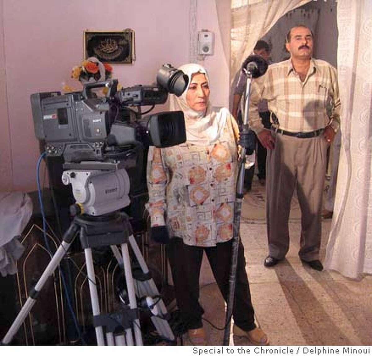 """Iraq-TV.JPG Sound engineer Iman Kassem, right, on duty on the set of """"The End,"""" a new show produced by Iraq's new al-Sharqiya satellite television network as actor Diadin Sami walks through the set. DELPHINE MINOUI /Special To The Chronicle Delphine Minoui"""