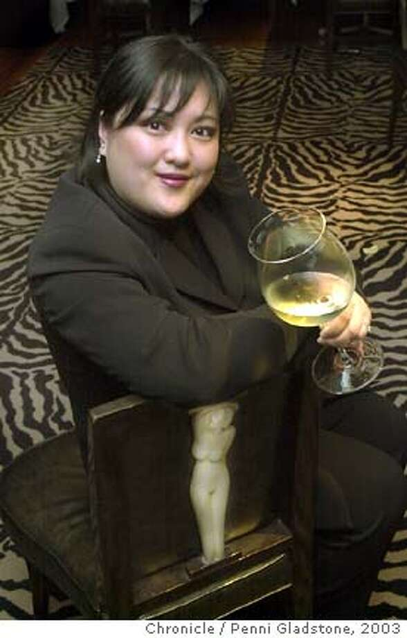 SOMMELIER18016_pg.jpg  Belinda Chang, a sommelier at the Fifth Floor restaurant.  9/15/03 in San Francisco PENNI GLADSTONE / The Chronicle Photo: PENNI GLADSTONE