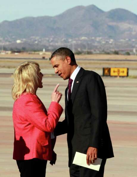 Arizona Gov. Jan Brewer points at President Barack Obama as they talk on the tarmac at Phoenix-Mesa Gateway Airport on Wednesday. Photo: Haraz N. Ghanbari / AP