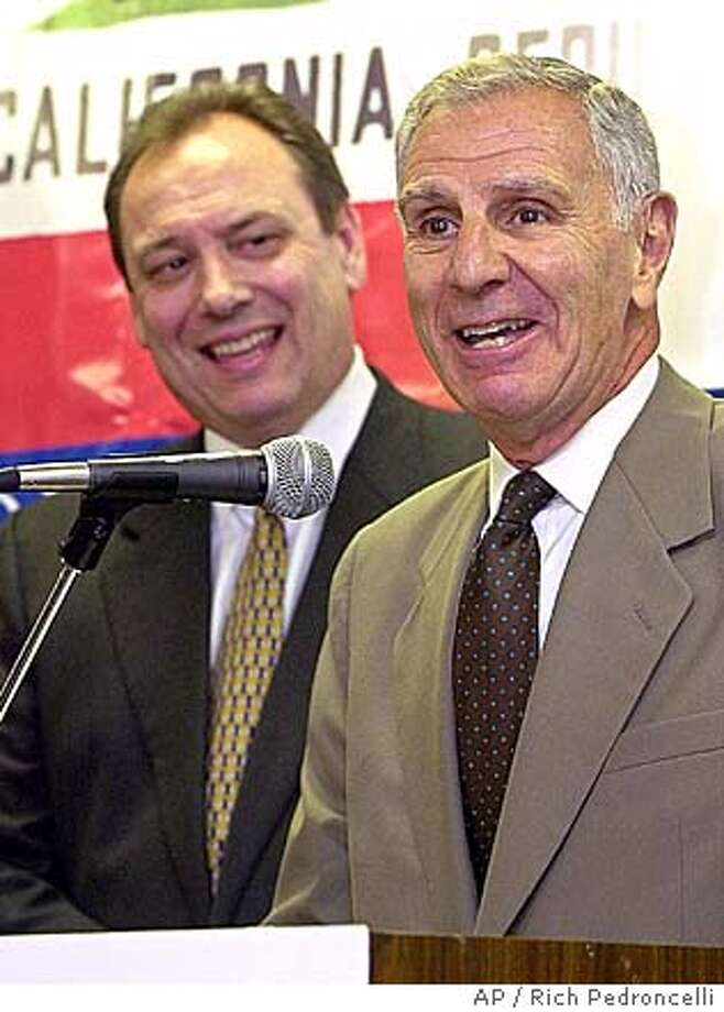 Republican gubernatorial candidate, Secretary of State Bill Jones, left, looks on as former California Gov. George Deukmejian anwers questions during a news conference Wednesday, June 20, 2001, in Sacramento, Calif. It was announced Wednesday that Jones has tapped the former two-term governor to chair his campaign. (AP Photo/Rich Pedroncelli)  also ran 01/04/2004, 03/06/04 CAT Photo: RICH PEDRONCELLI
