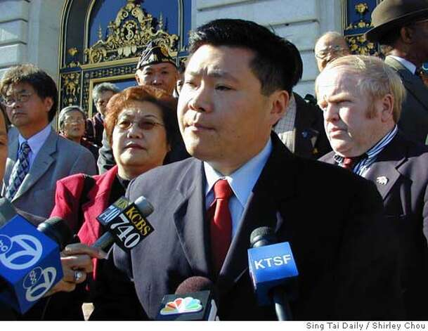 ANDREW LEE.JPG Andrew Lee and Julie Lee (behind him to the left) on the steps of city hall when he resigned from the city Public Utilities Commission in November. MUST CREDIT: Sing Tai Daily/Shirley Chou